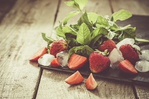 Strawberry mojito ingredients on rustic background