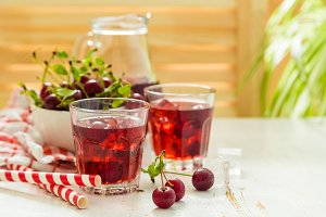 Cold cherry summer drink in glasses