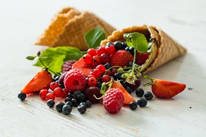 Selection of fresh berries in waffle cones