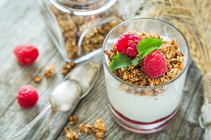 Granola with rasberry and yogurt in glass