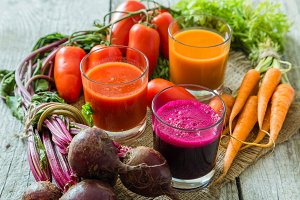 Selection of vegetable juices in glasses and ingredients