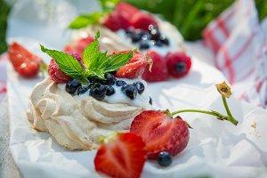 Mini pavlova with berries on picnic