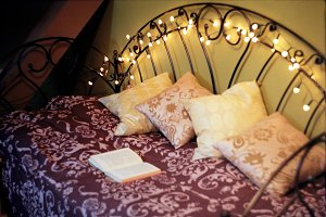 Dreamy bed with an open book