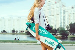hipster girl posing with longboard