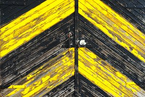 Wooden gate painted yellow