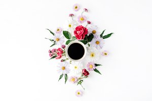 Coffee mug and floral composition