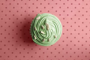 Green cupcake With whipped cream