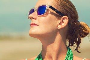 blond woman on the beach sunbathing