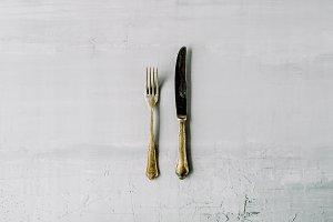Fork & knife on concrete background