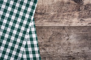 Green tablecloth and rustic wood