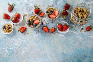 Healthy breakfast of muesli, strawberry on blue background, top view, Copy space.