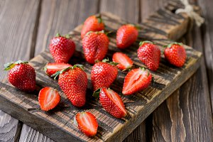 Strawberry on a chopping wooden board