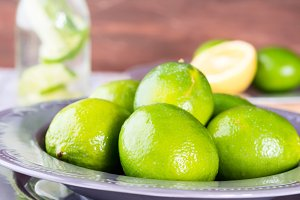 Fresh whole limes and water