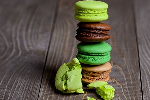 Colorful macaroons tower on wooden background