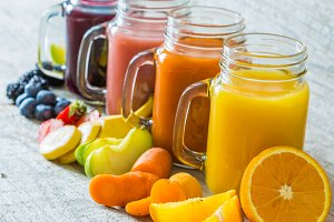 Slection of fresh fruit juices in jars
