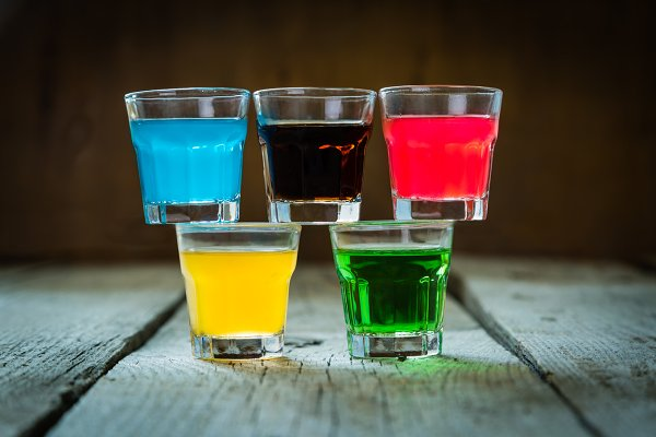 Selection Of Colorful Shot Drinks On White Wood Background High