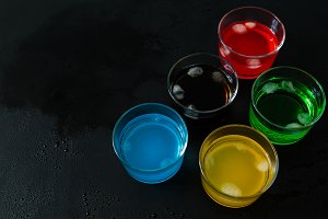 Selection of colorful drinks on white wood background