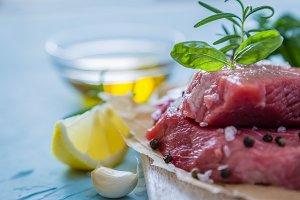 Raw meat with herbs, lemon, garlic, salt