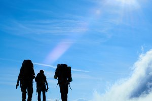 Silhouettes of hiking friends