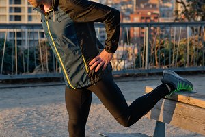 runner stretching leg on the table