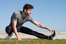 The athlete stretching leg