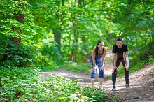 Fitness healthy lifestyle of young couples training for marathon run outside in park