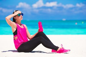 Fit young woman in her sportswear during beach vacation