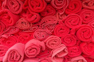 Stack roll of bath red towels