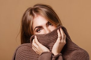 Girl wrapped in a warm sweater. Sick
