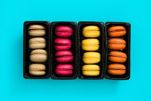 Colored macaroons on blue background