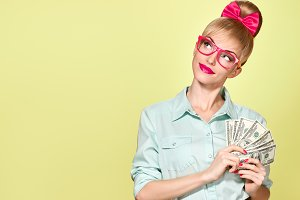 Fashion. Woman in Glasses with Dollar Bill, cash