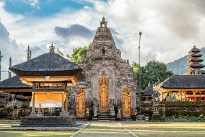 Buddhist stupa in gardens of Pura Ulun Danu pagoda temple on a lake Bratan, Bali, Indonesia