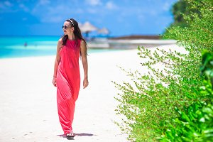 Young happy woman during tropical beach