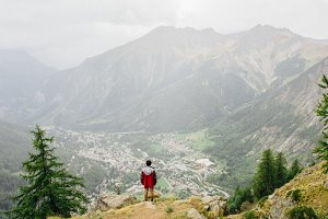 Hiker enjoys the view in the Alps
