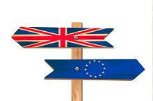 Two wooden signs - UK and EU. Brexit