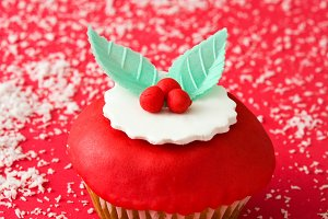 Christmas cupcake on red background