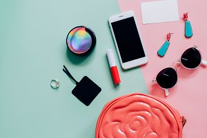 Flat lay of woman bag with cosmetics