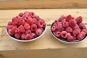 frozen raspberries in two bowls