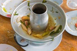 Scraps of food left in soup pot