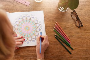 Woman coloring with color pencils