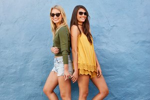 Trendy female friends in stylish