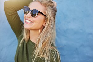 Cheerful young woman in sunglasses