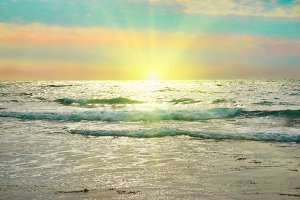 Sea, sun, waves and clouds