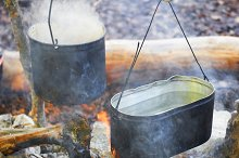 Boiling water in two pots