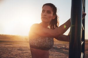 Fitness woman standing outdoors