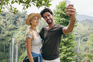 Loving couple taking selfie