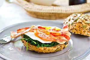 Bacon,egg and spinach on healthy bun