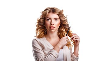 Girl with curly hair combing