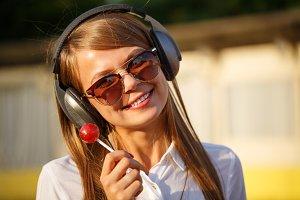 Girl holding a lollipop. Music