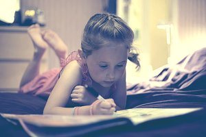 Little Girl Reading and Writing